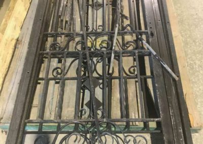 Wrought iron screen door awaiting powder coating