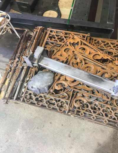 Variety of homeware equipment and wrought iron latticed sections that have not yet been abrasive blasted. These are a part of the home pick up and delivery service offered by Hartech