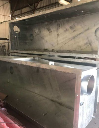 Showing the inside capacity gas storage sumps that have been abrasive blasted undercoated and then powder coated both on the inside and outside