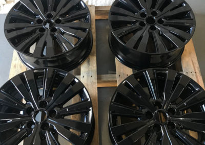 4 mag wheels that have been abrasive blasted undercoated and powder coated