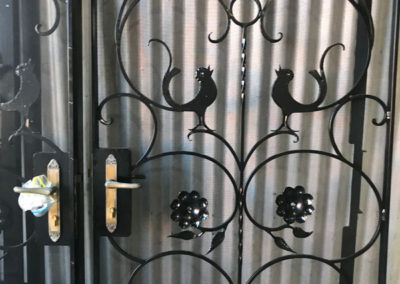 A set of 4 ornate gates which have been restored, which included abrasive blasting, undercutting and powder coating the gates and the fly screens, and hand polishing the locks