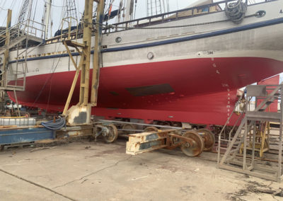 The hull of the One and All Tall ship after there was 5 coats of paint were applied including 3 coats of ozone coating (primer/sealer) plus two coats of anti fouling