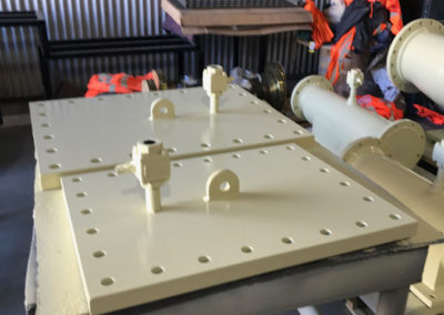 Flange panels for supporting new piping for mining in outback Australia. Delivered after being newly fabricated and nartchhave undercoated and surface coated