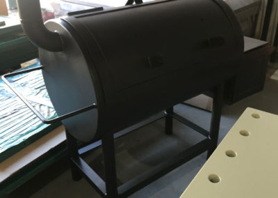 Outdoor metal smoker which has been abrasive blasted and painted black