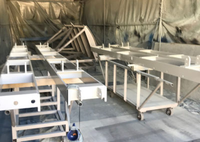 Water control Barges form the Murray river which are dissembled abrasive blasted undercoated and spray painted with three top Coats
