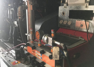 The industrial blasting equipment installed in a shipping container has to be resprayed orange