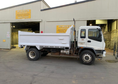 Truck bin on tip truck which was abrasive blasted, epoxy primed and Polyurethane top coat applied whilst still attached to the truck and the company signage applied - after